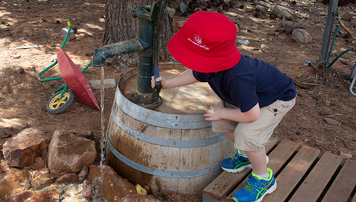 Port-Augusta-West-Childhood-Services-Centre-Outdoor-Play-Nature-Based-Water-Pump-Exploration