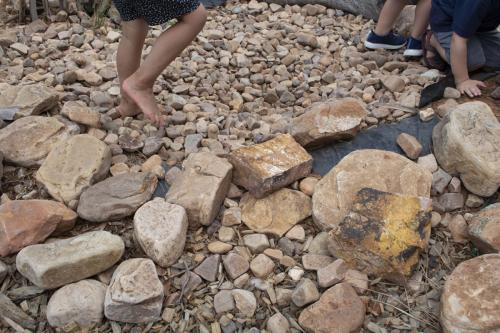 Port-Augusta-West-Childhood-Services-Centre-Creek-Bed-Rocks-Shoes-off-Play-Nature-Based-Preschool